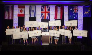 AEPi's ten beneficiaries gather on stage to be recognized at the Official Philanthropy Lunch and receive their donation check.