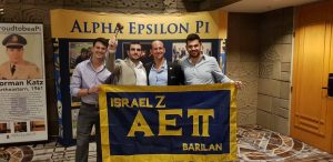 Vav/Israel Zeta Brothers take a photo with their chapter flag and gavel after being announced as a fall 2018 colony that would receive its charter.