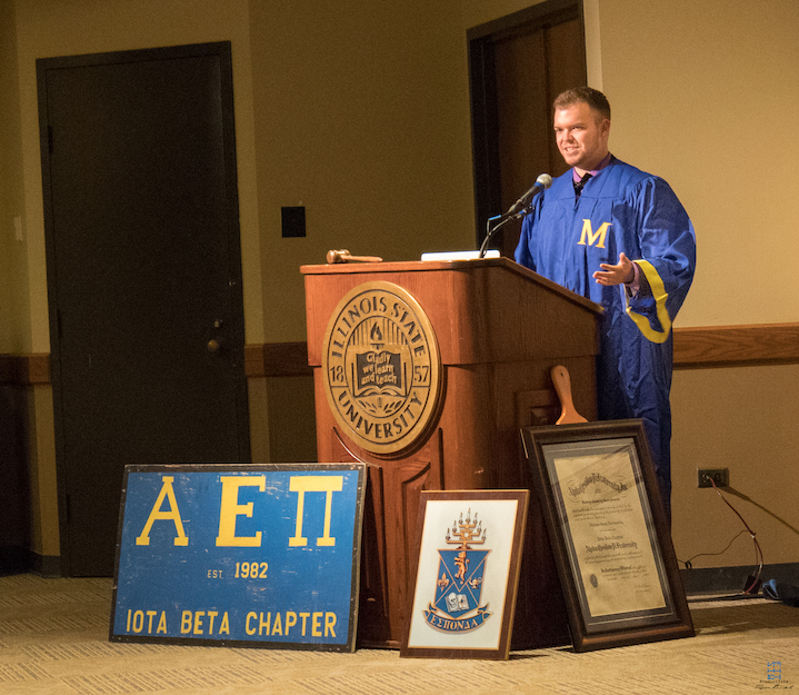 Illinois State Chartering Master Ethan Shemoney (2018) makes an acceptance speech after receiving the charter.