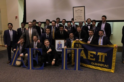 Quinnipiac University Chartering Nu Eta Brothers pose for a group photo after receiving their charter.