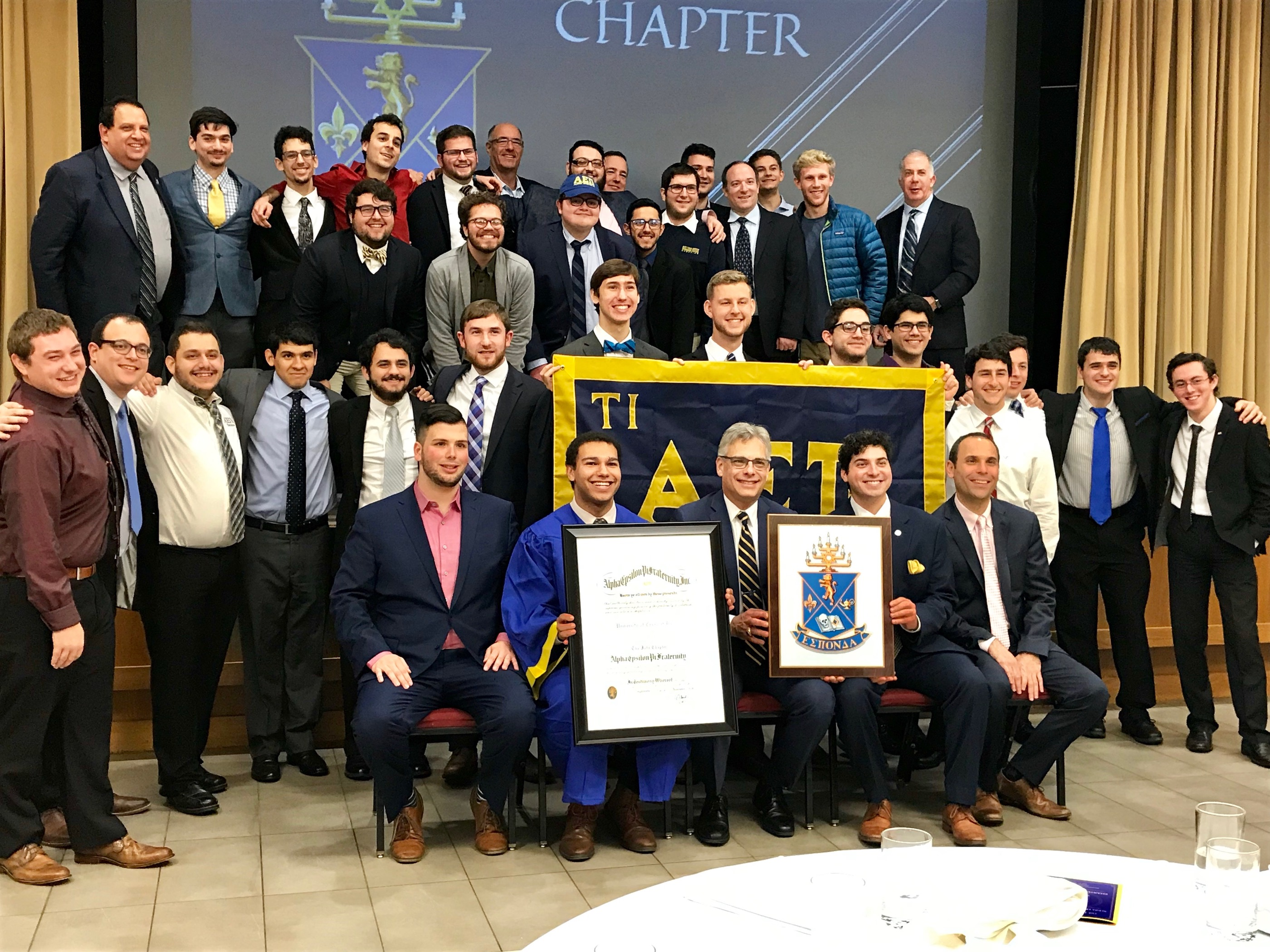 Brothers of Tau Iota take a group photo with Educational Leadership Consultant (ELC) Justice Roy (North Texas, 2017) and Supreme Master Jeff Jacobson (Northern Arizona, 1992).