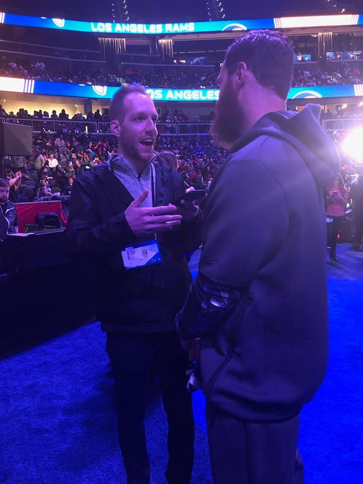 Will Collins (Kent State, 2014) at Super Bowl Week talking to Julian Edelman